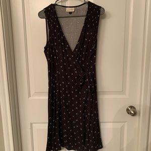 Black wrap dress with gray/blue floral pattern